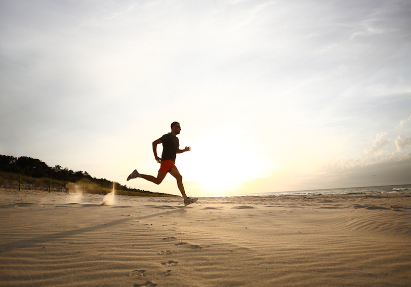 Silhouette of man running on a beach