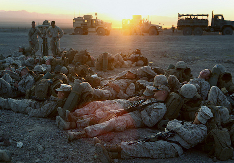 Group of Marines sleeping on the ground near their vehicles at sunset (U.S. Marine Corps photo by Sgt. Anthony Ortiz)