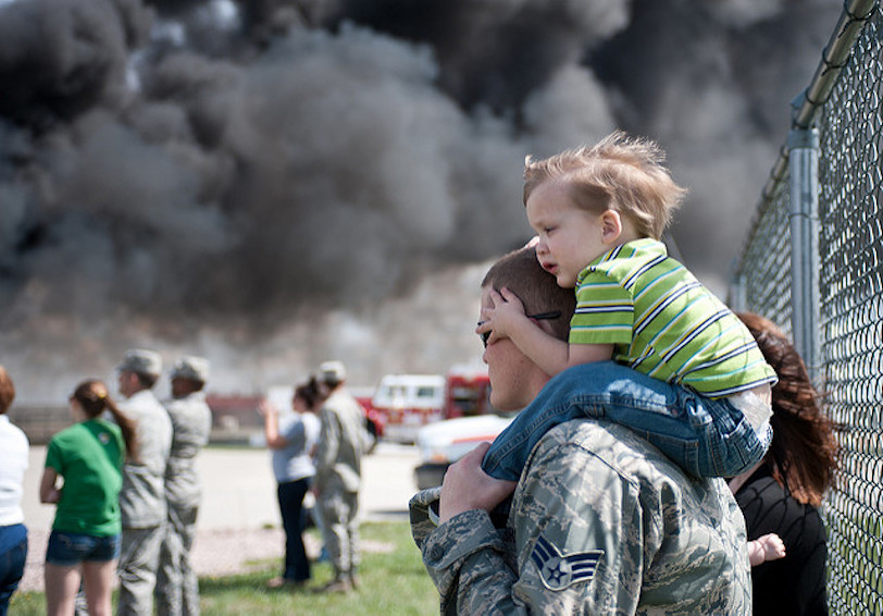 Little boy sitting on his dad's shoulders (U.S. Air Force photo by Airman 1st Class Alystria Maurer)
