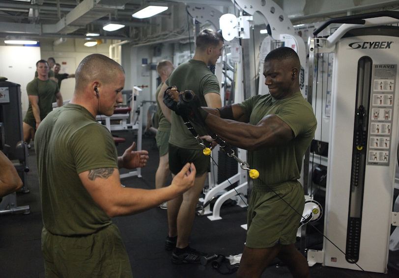 Marines lifting weights in weight room (Official USMC photo by Sgt. Jesse J. Johnson/ Released)