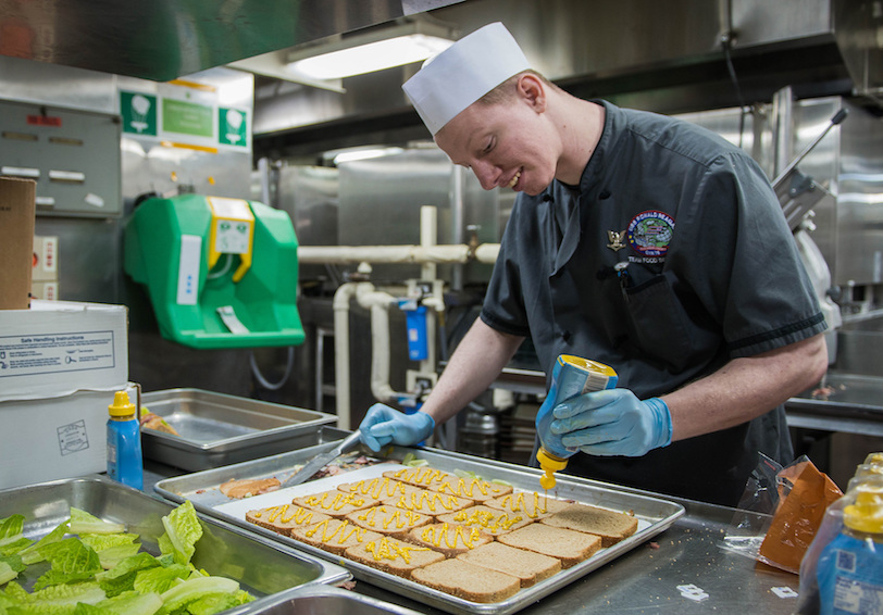 Sailor prepares sandwiches (U.S. Navy photo by Mass Communication Specialist 3rd Class Cody Hendrix/Released)