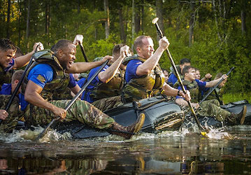 Paratroopers rowing rafts. U.S. Army photo.
