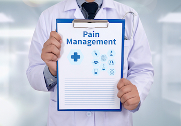 Doctor holding clipboard with the words  Pain Management