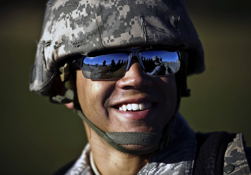 Airman laughs after a long day of training   U S  Air Force photo by Staff Sgt  Jonathan Snyder