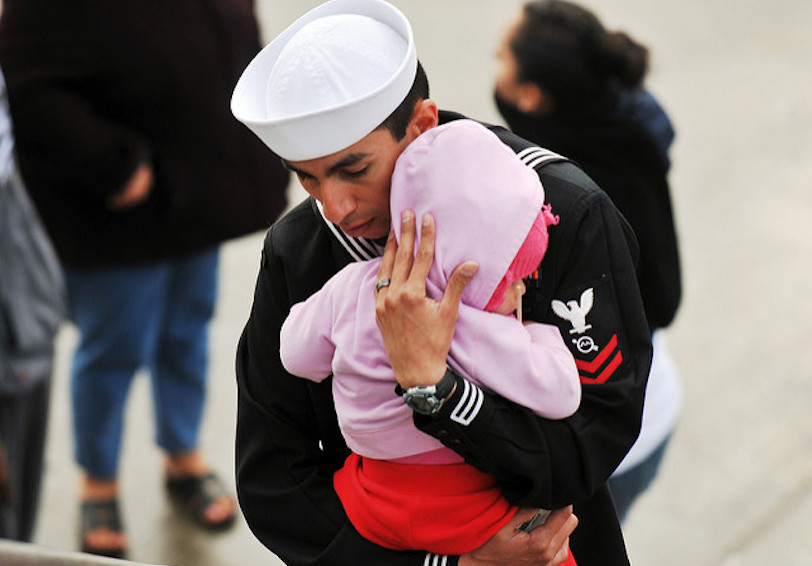 Sailor hugging his small daughter (U.S. Navy photo by Mass Communication Specialist Seaman Benjamin Crossley/Released)
