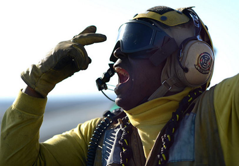 Sailor wearing protective gear points to eyes  U S  Navy photo by Mass Communication Specialist 2nd Class Tony D  Curtis