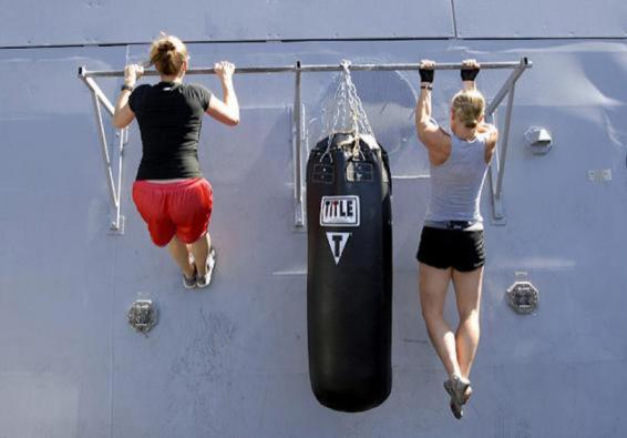 Sailors doing pull-ups (U.S. Navy photo by Mass Communication Specialist 1st Class Elizabeth Merriam/Released)
