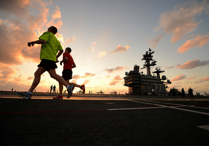 Sailors running on ships deck (U.S. Navy photo by Mass Communication Specialist 2nd Class Tony D. Curtis/Released)
