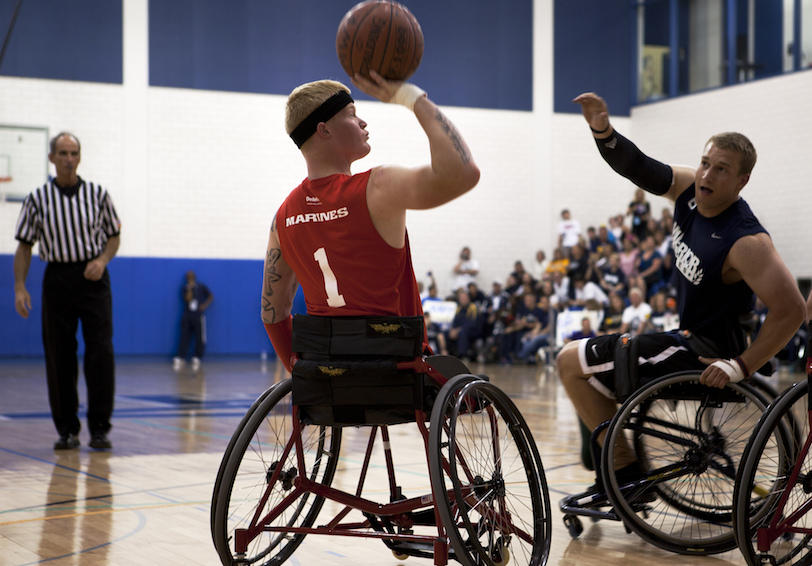 A Marine prepares to take a shot during a wheelchair basketball game  U S  Marine Corps photo by Lance Cpl  Chelsea Flowers