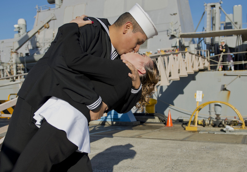 A Sailor kisses his wife. (U.S. Navy photo by Mass Communication Specialist 3rd Class Gregory A. Harden  II/Released)
