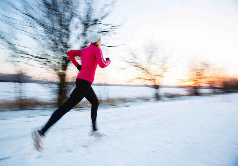 Woman running outside on snowy day