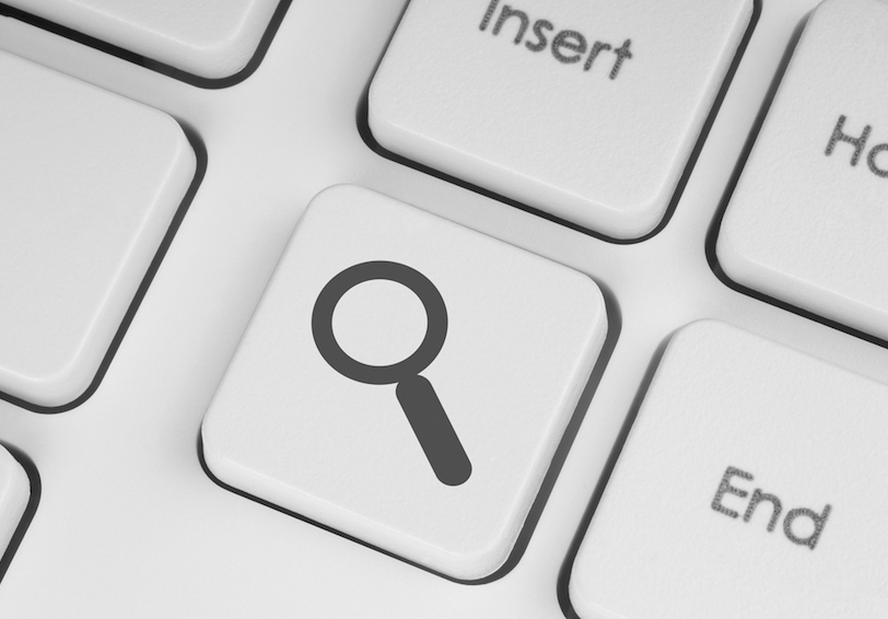 Key on keyboard showing a magnifying glass icon