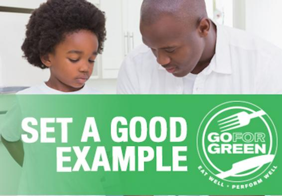 Set a Good Example. Go for Green logo: Eat well. Perform well. Plate with fork and  knife.