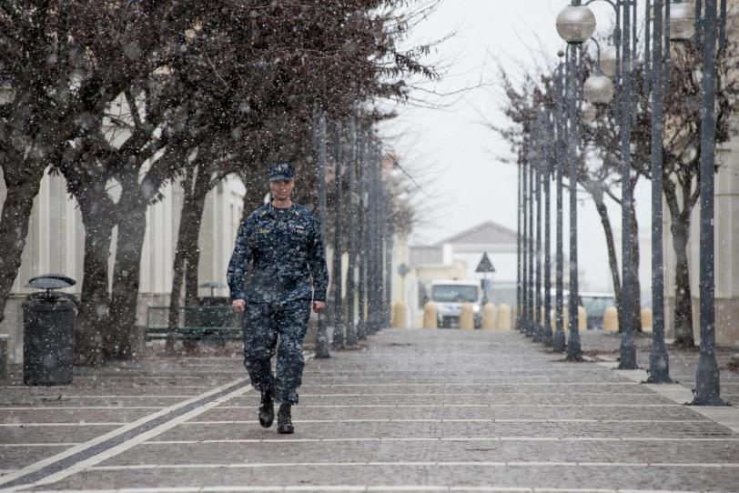 A Sailor walks through snow (U.S. Navy photo by Mass Communication Specialist 3rd Class Daniel P. Schumacher/Released)
