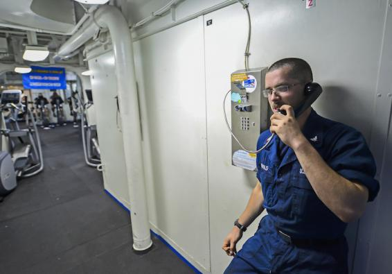 A Sailor calls home. (U.S. Navy photo by Mass Communication Specialist 3rd Class Conor Minto/Released)