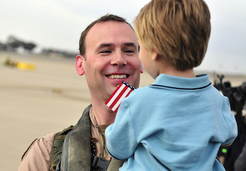 Pilot greets his son after deployment  U S  Navy photo by Mass Communication Specialist Seaman Benjamin Crossley Released