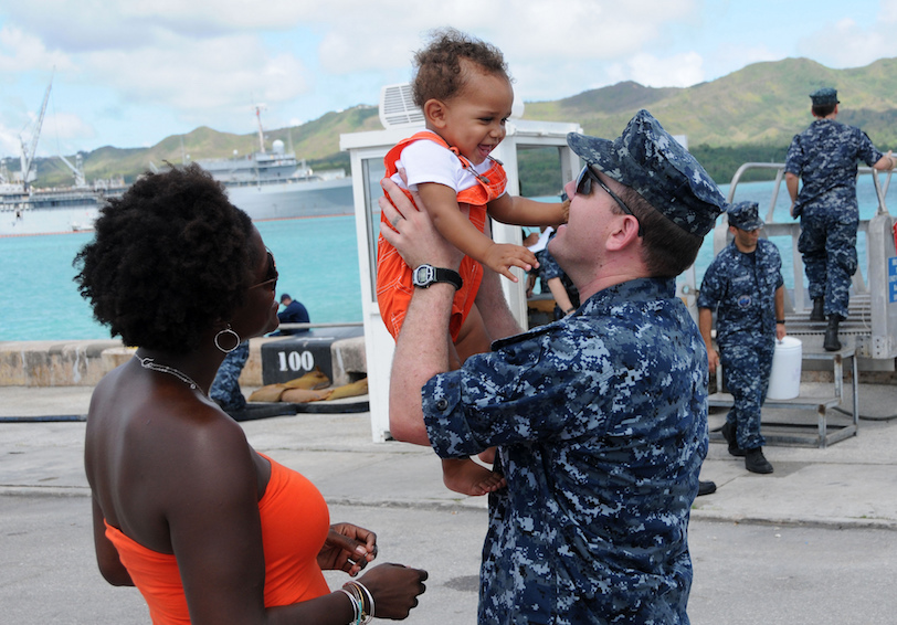 Sailor greets his family. U.S. Navy photo by Mass Communication Specialist 1st Class Jeffrey Jay Price/Released