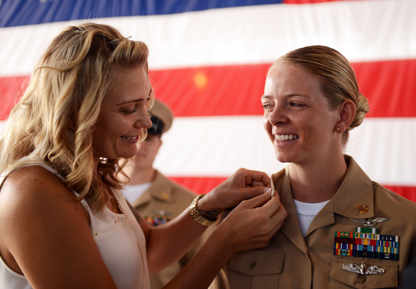 Chief Aviation Ordnanceman is pinned by her wife. U.S. Navy photo by Mass Communication Specialist 2nd Class Stephanie Smith.