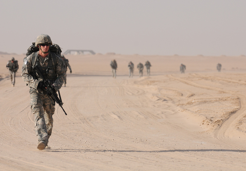 Soldiers completing ruck march in sunny dry terrain (DoD photo by Cpl. Trisha Betz, U.S. Army/Released)