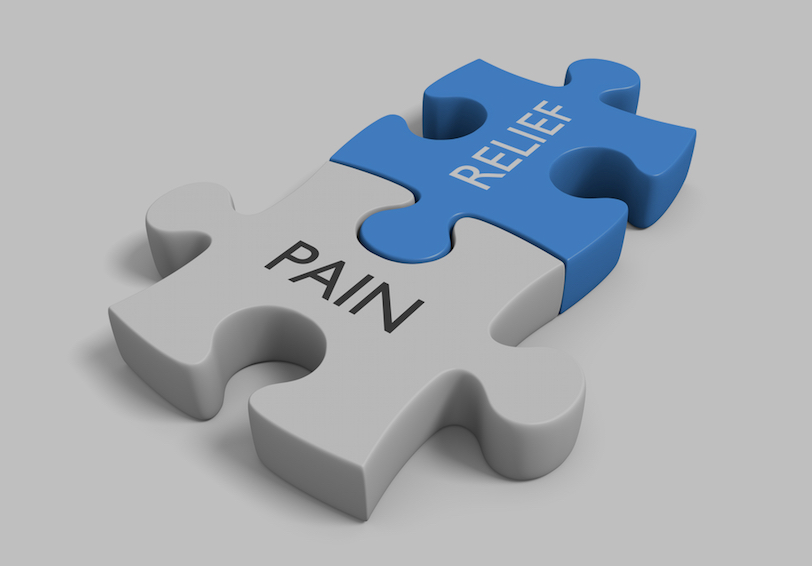 "Two puzzle pieces fitted together labeled ""Pain"" and ""Relief"""