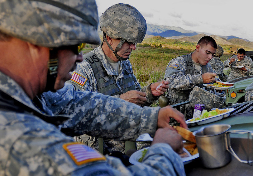 Soldiers eat dinner in the field. Photo by Staff Sgt. Joseph Rivera Rebolledo.