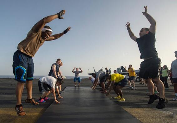 Sailors participate in a fitness challenge. (U.S. Navy photo by Mass Communication Specialist Seaman Andrew Schneider/Released)
