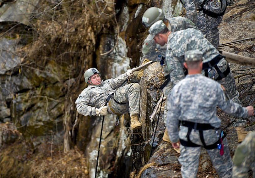 Group of soldiers climbing on rocky, steep terrain (US Army Photo by John D. Helms)