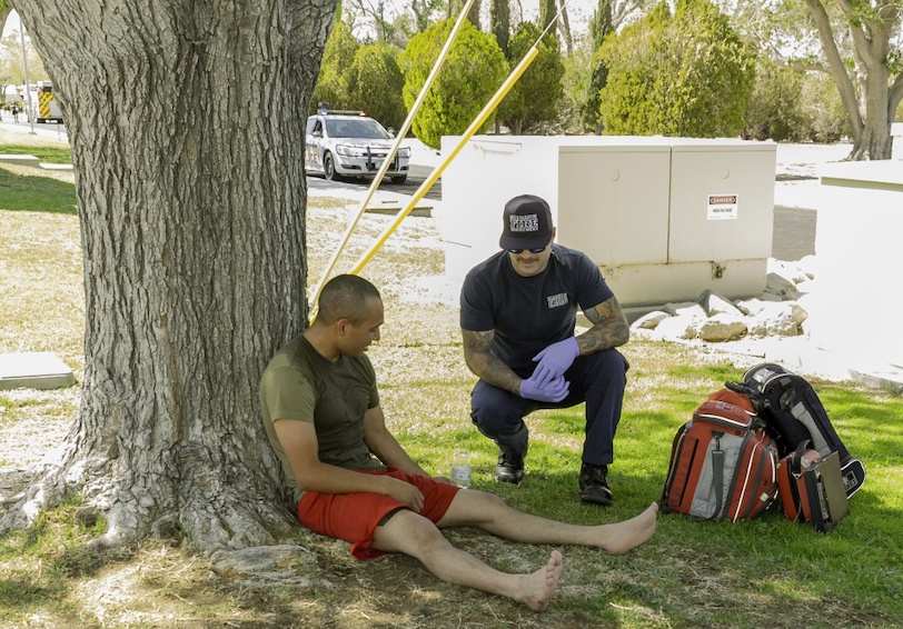 EMS treats an injured Marine who was showing symptoms of a heat related illness. Photo by Jack Adamyk.