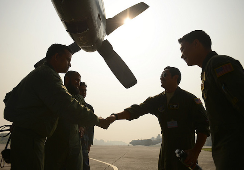 Group of airmen talking and shaking hands on air strip (U.S. Air Force photo by 1st Lt. Jake Bailey/Released)