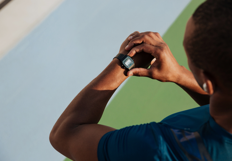 Man looking at wrist heart rate monitor