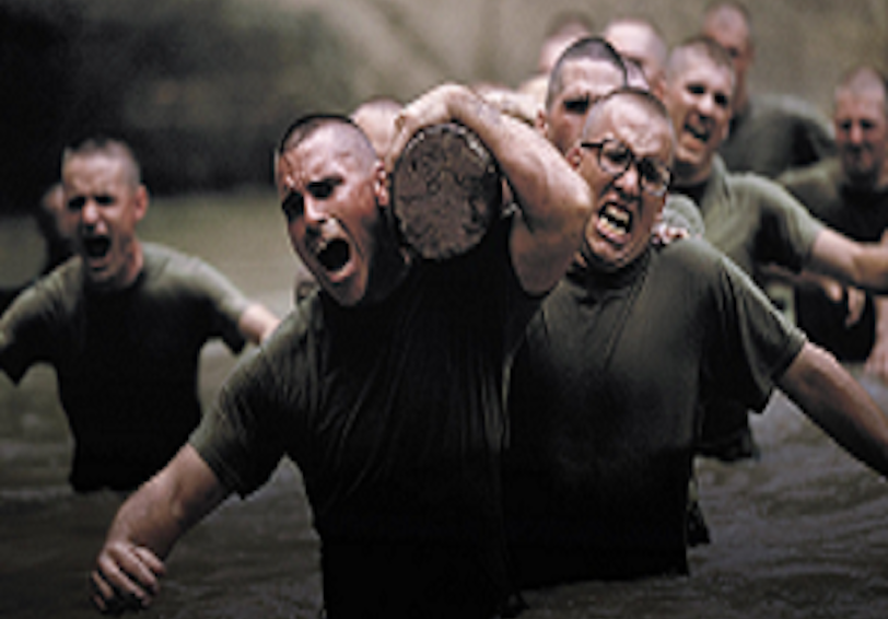 Marine recruits performing a log carry (Photo by US Marine Corps)
