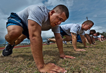 Airmen doing mountain climber exercises (US Air Force photo)