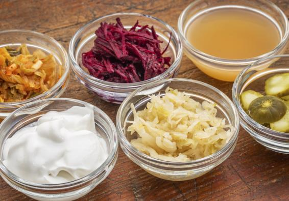 Small bowls with probiotic foods such as sauerkraut, kimchi, and yogurt