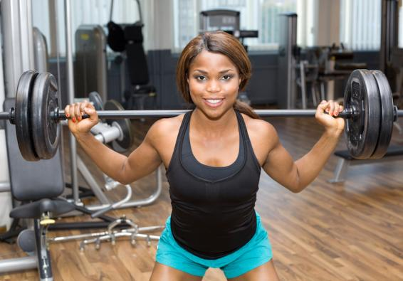 Woman holding barbell and weights