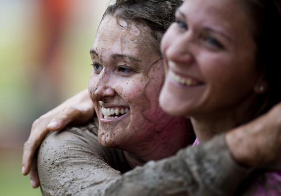 Women hug after completing Women s History Month Ultimate Dirty Dash   U S  Air Force photo by Senior Airman Clayton Lenhardt