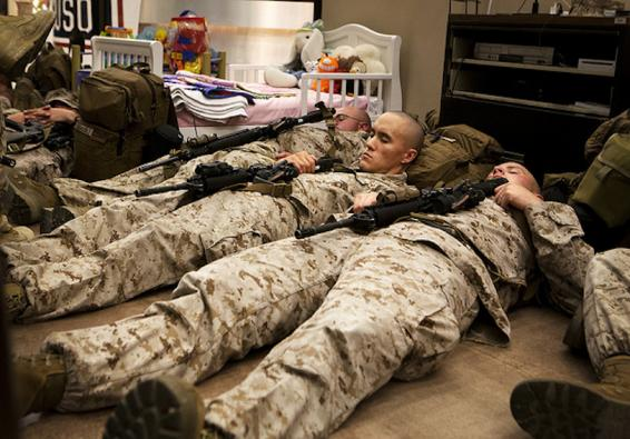Marines and sailors rest in the USO prior to boarding a plane to Kyrgyzstan   U S  Marine Corps photo by Cpl  Alejandro Pena