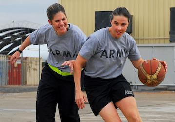 Women playing basketball  U S  Army photo by Spc  Samuel Soza