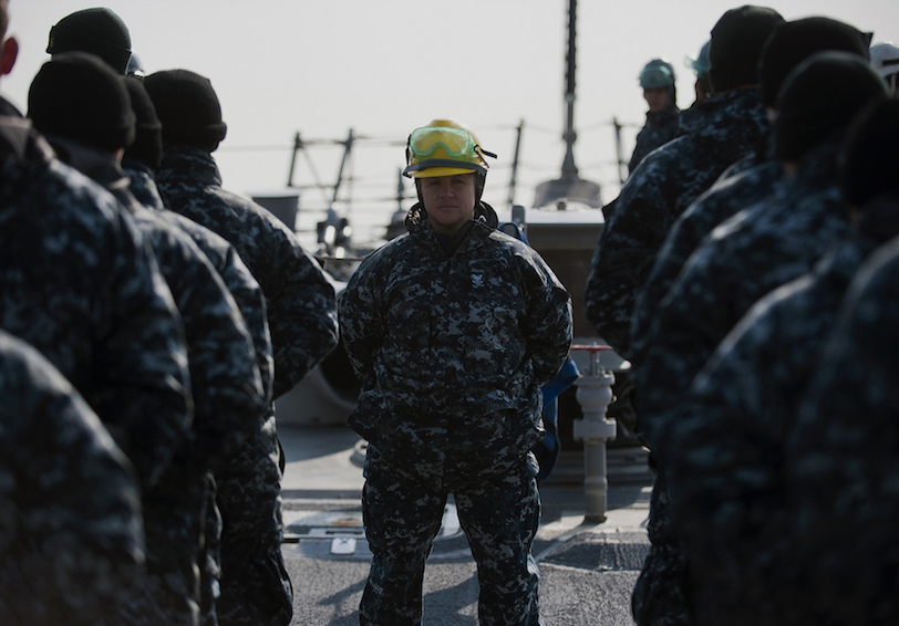 Sailor leads her shipmates as ship gets underway. U.S. Navy photo by Mass Communication Specialist 2nd Class James R. Evans.