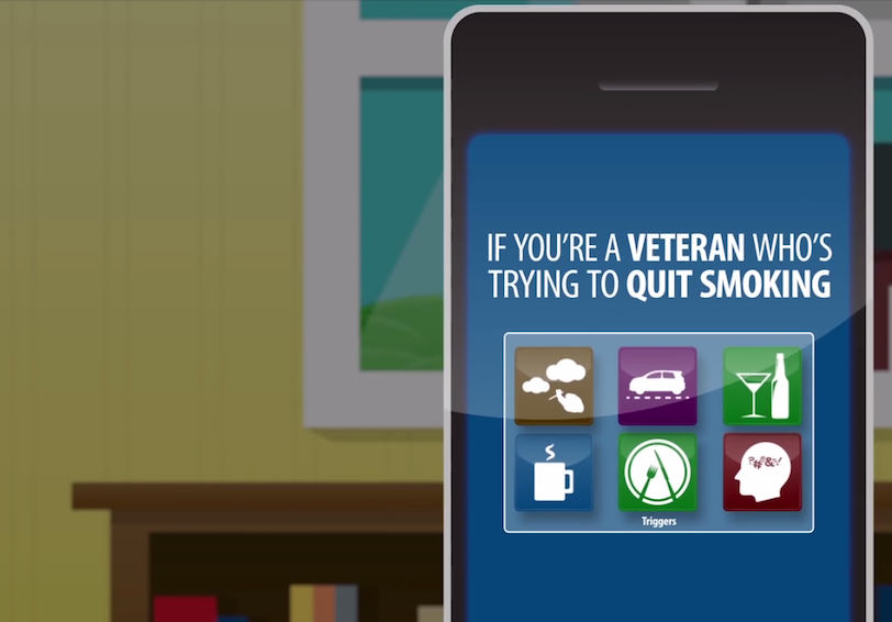 "Still from video showing a cell phone with the words ""If you're a veteran who's trying to quit smoking"""