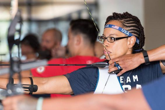 U S  Army Staff Sgt  takes aim at the target during archery practice  U S  Army photo